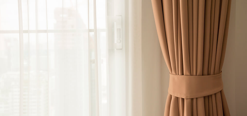 Add a sense of space with your window coverings