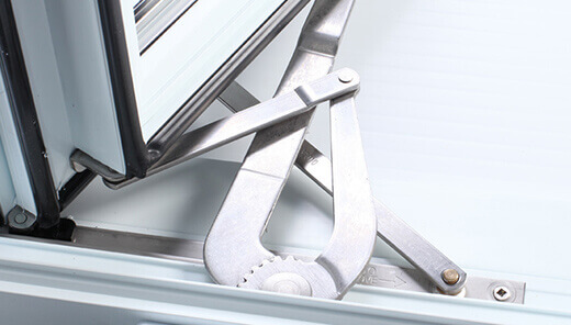 View of the mechanism at the bottom of a window for an example of durable stainless steel hardware for your awning windows